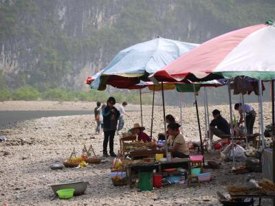 Food stalls on a bank in the Li River