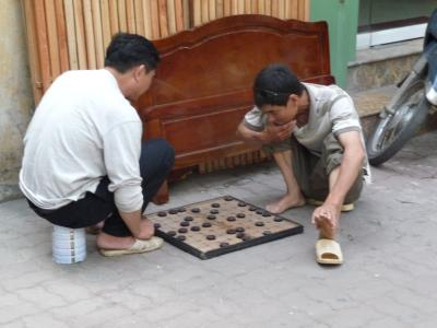 Playing games on the street in Hanoi