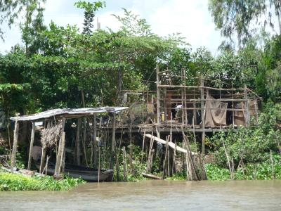 Shacks on the banks of the Mekong river