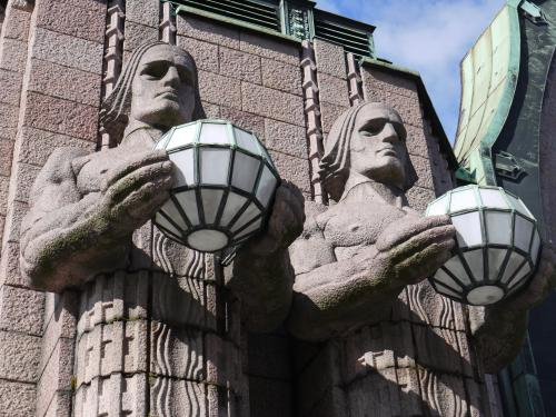 Statues at the entrance to the main train station, Helsinki
